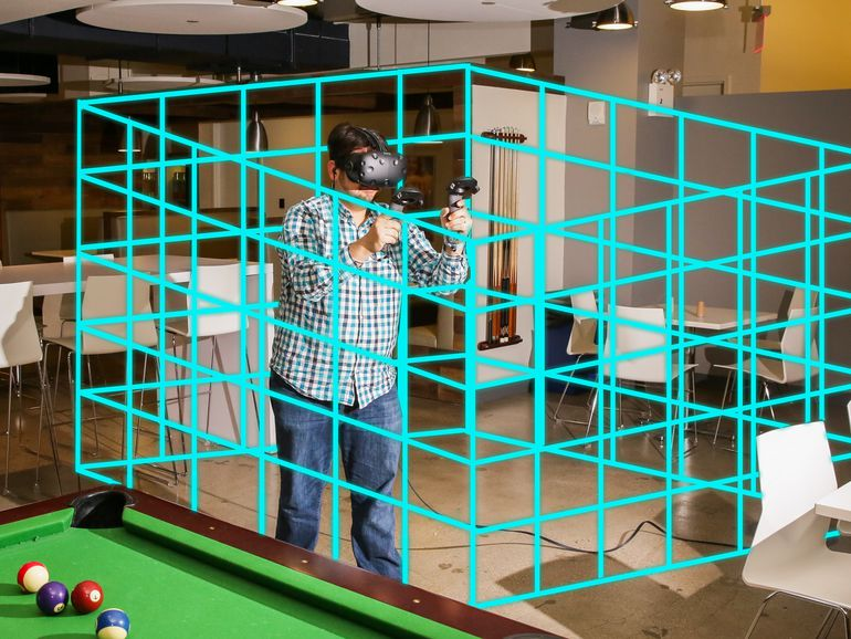 HTC Vive Room Scale Layout throws up a virtual blue grid to keep you in the preset boundaries of an immersive experience