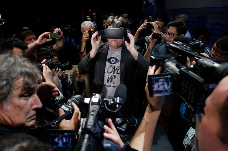 """""""Oculus founder Palmer Lucky is surrounded by photographers after introducing the Rift virtual reality headset during a press event in San Francisco, Calif., Thursday, June 11, 2015. (Karl Mondon/Bay Area News Group)"""""""