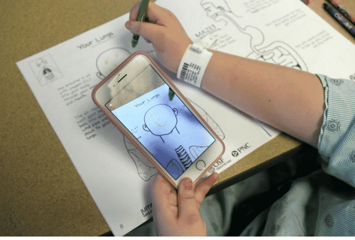 AR Activity Book in use at OSF Healthcare Children's Hospital of Illinois.